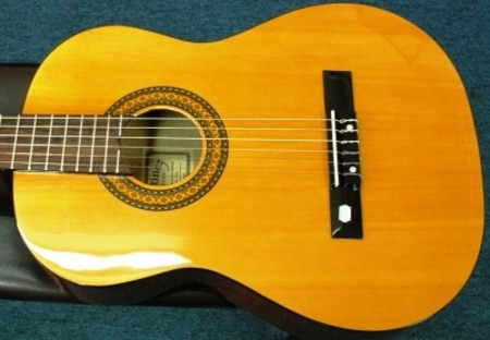 Spruce Top Agathis Back And Sides Nato Fingerboard Bridge Made As A Right Hand Guitar But Set Up Left Handed In The Shop