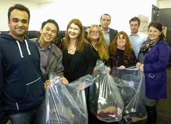 The team from ASIC visit Ready to Work's offices to donate clothing